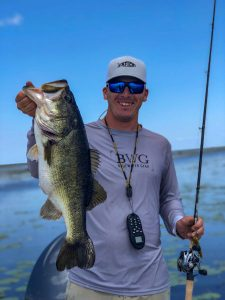 good size bass held by man