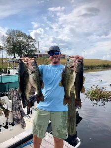 large mouth bass caught by a man in Okeechobee