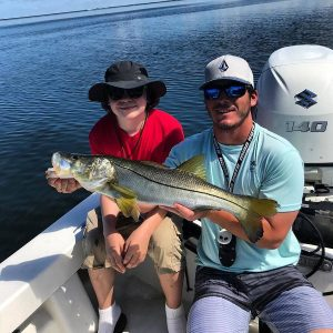 Snook caught by a young man in Sarasota