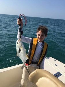 Pompano caught by a boy in Sarasota
