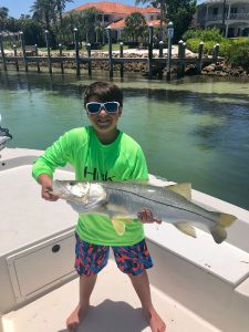 kid with snook in Sarasota